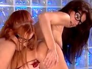 Redhead lesbian licking and dildoing beauty girl