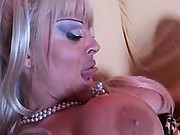 Two gorgeous lesbians enjoy on sofa