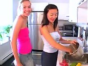 Asian teenage lesbian spoiling blonde on kitchen