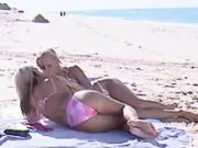 Two yummy lesbians caress on beach